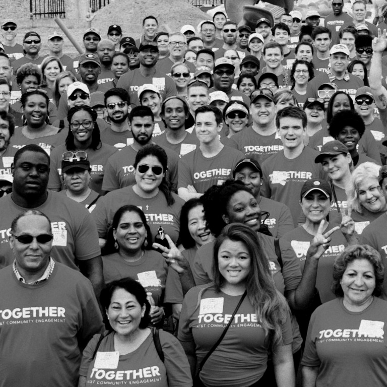 Group of people wearing a together AT&T community engagement t shirts
