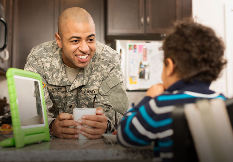 Veterans: a veteran hangs out with his son in the kitchen.