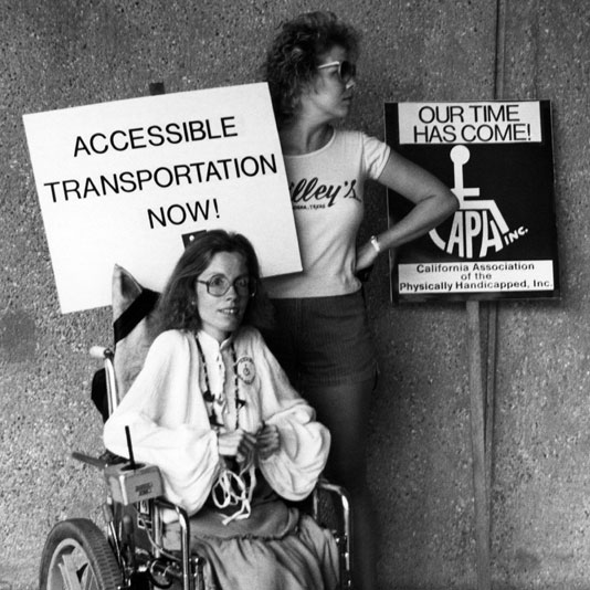 Protesters in front of building asking for accessible transportation