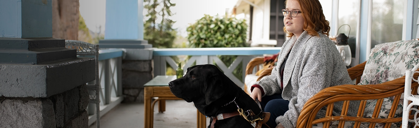 Woman sitting with seeing-eye dog