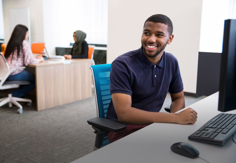 An AT&T employee sitting at a computer