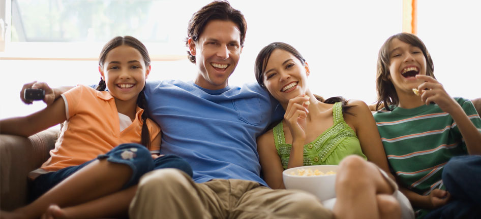 family_watching_movie_946x432.jpg