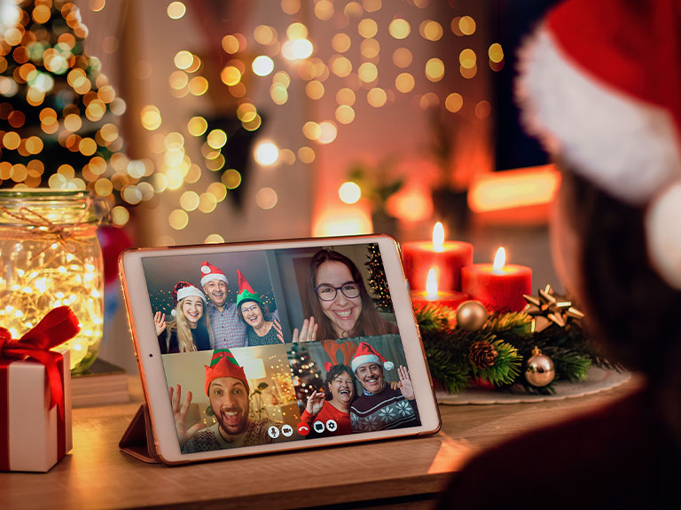 A family has a holiday video call on an iPad using the AT&T network.