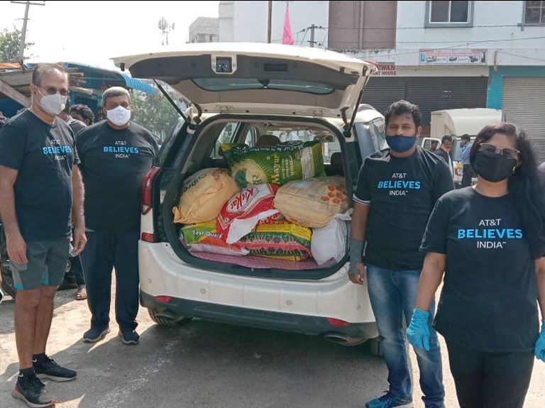 AT&T Believes India volunteers deliver food for children